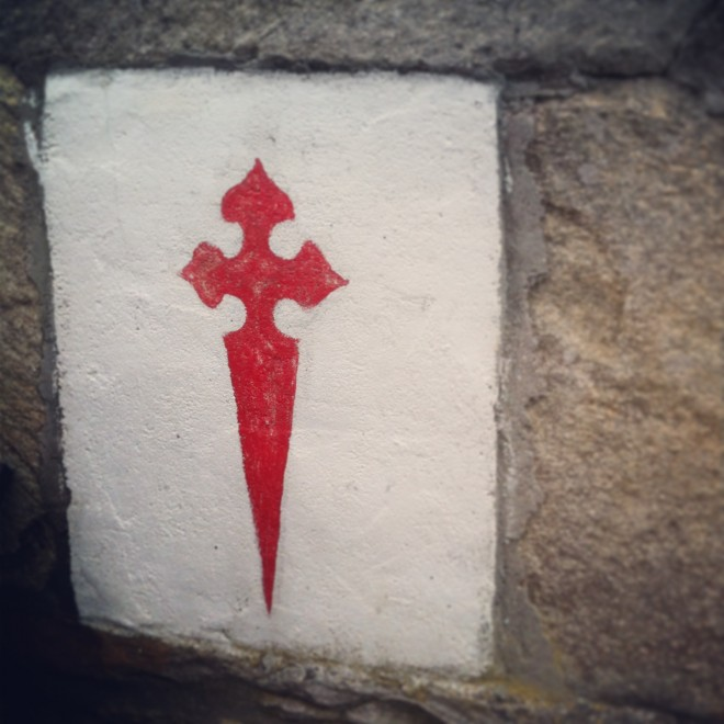 Cross of Santiago, found on a wall on The Way