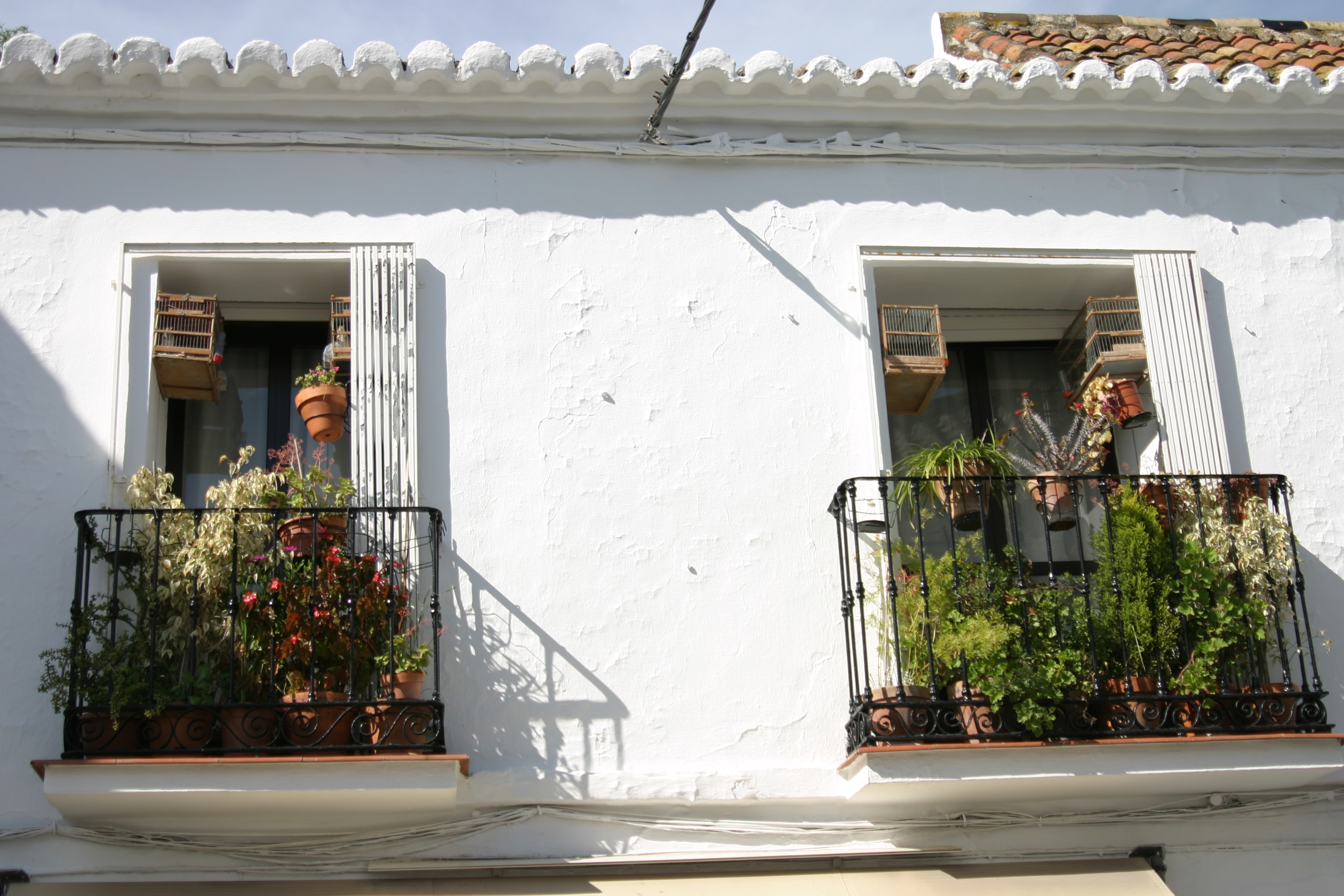 Mijas Pueblo, canary cages and flower pots www.andrewforbes.com